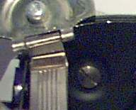 Fig 6, screw underneath film speed reminder dial